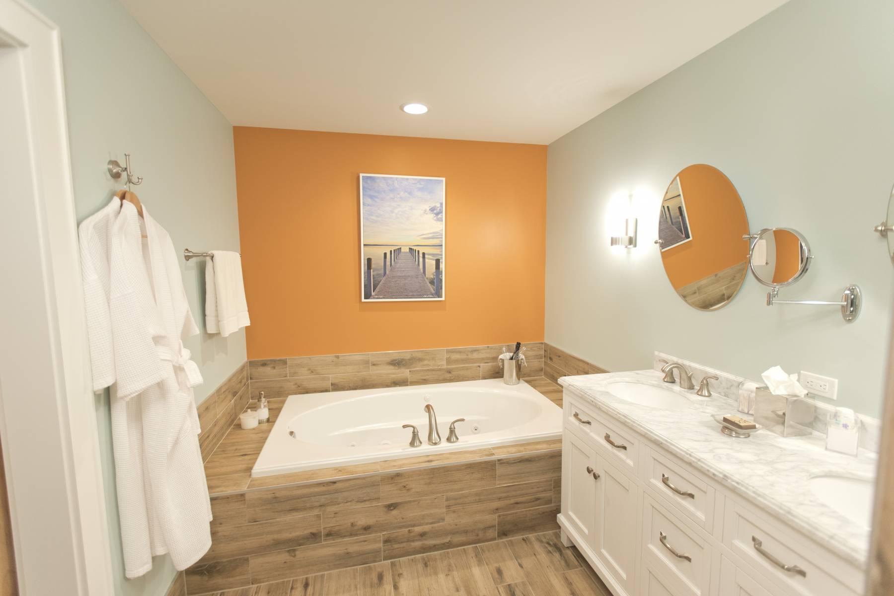 Bainbridge Bathroom with two person spa tub and heated floors.